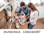 couple cooking together at home.... | Shutterstock . vector #1266166387