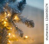 christmas tree closeup  light... | Shutterstock . vector #1266430174
