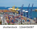 commercial container port in... | Shutterstock . vector #1266436087