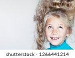 little girl with long hair.... | Shutterstock . vector #1266441214