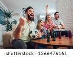 happy friends or football fans... | Shutterstock . vector #1266476161
