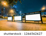 blank billboard on bus stop at... | Shutterstock . vector #1266562627