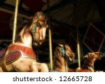 Carousel Horses With A Vintage...