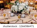 wedding dinner table decor.... | Shutterstock . vector #1266586471