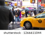 blurred picture of a yellow cab ... | Shutterstock . vector #1266611044