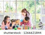 science teacher teach asian... | Shutterstock . vector #1266621844