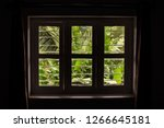 a dimly lit window with a view...   Shutterstock . vector #1266645181
