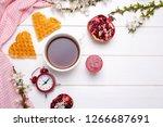 a cup of tea  waffles ... | Shutterstock . vector #1266687691