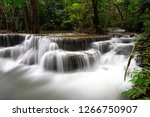 waterfall and blue stream in... | Shutterstock . vector #1266750907