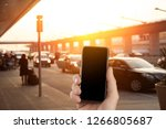 person waiting and using taxi... | Shutterstock . vector #1266805687