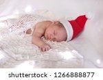 new born baby sleeping in santa ...   Shutterstock . vector #1266888877
