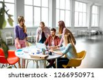 group of a young coworkers... | Shutterstock . vector #1266950971