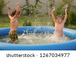 two boys playing together in... | Shutterstock . vector #1267034977