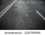 asphalt road with white stripes | Shutterstock . vector #126704969