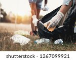 woman hand picking up garbage...   Shutterstock . vector #1267099921