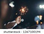 hand holding a burning sparkler ...   Shutterstock . vector #1267100194