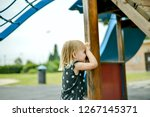the baby girl is playing hide... | Shutterstock . vector #1267145371