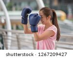 beautiful woman wearing boxing... | Shutterstock . vector #1267209427
