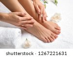 woman touching her smooth feet... | Shutterstock . vector #1267221631