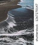 sea wave on sand beach photo... | Shutterstock . vector #1267270147