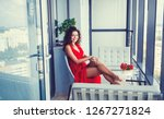 beautiful elegant woman in red...   Shutterstock . vector #1267271824