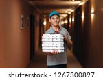 delivery man with fresh pizza... | Shutterstock . vector #1267300897