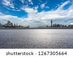 empty asphalt road with city... | Shutterstock . vector #1267305664