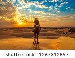 female tourist on camel safari...   Shutterstock . vector #1267312897