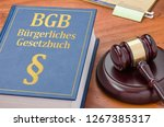 a law book with a gavel  ... | Shutterstock . vector #1267385317
