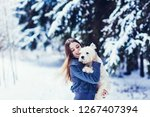 pretty young woman playing with ...   Shutterstock . vector #1267407394