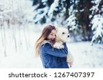 happy girl with her dog  white...   Shutterstock . vector #1267407397