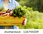 senior woman holding box with... | Shutterstock . vector #126744209
