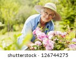 senior woman with flowers in