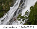 Small photo of The impetus and the power of water at Toce waterfalls in the Italian Alps