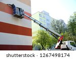 painting the facade from at a... | Shutterstock . vector #1267498174