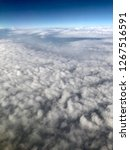 aerial view of clouds and a the ... | Shutterstock . vector #1267516591