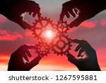 gears hands of people on the... | Shutterstock . vector #1267595881