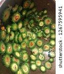frying bitter gourd  bitter... | Shutterstock . vector #1267595941