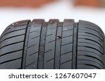 summer car tire. rusty nail in...   Shutterstock . vector #1267607047