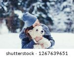 young dog owner girl plays with ...   Shutterstock . vector #1267639651