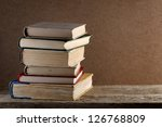 pile of old books on wooden... | Shutterstock . vector #126768809