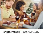 friends making a toast while... | Shutterstock . vector #1267698607