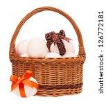 raw eggs in a wicker basket... | Shutterstock . vector #126772181