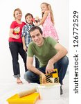 Family redecorating together - painting their home - stock photo