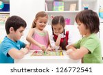 children playing board game  ... | Shutterstock . vector #126772541