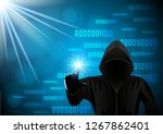 black hooded man  hacker on a... | Shutterstock .eps vector #1267862401