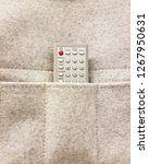 tv remote controller keeping in ... | Shutterstock . vector #1267950631