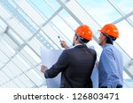 two men in hard hats at... | Shutterstock . vector #126803471