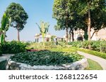 tropical trees park near... | Shutterstock . vector #1268122654