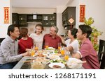 happy big asian family sitting... | Shutterstock . vector #1268171191